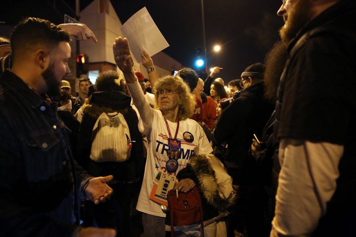 Donald Trump supporter Birgitt Peterson of Yorkville, Ill., argues with protesters outside the UIC Pavilion after the cancell