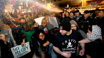 Police pepper spray a crowd of protesters and journalists outside the Arvest Bank Theater in Kansas City, Mo., on Saturday, March 12, 2016, during a rally for Republican presidential candidate Donald Trump. (Christopher Smith/Kansas City Star/TNS via Getty Images)