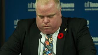 TORONTO, ON - NOVEMBER 5: Toronto Mayor Rob Ford, backed by brother Councillor Doug Ford (left) on November 5, 2013, speaks to the media following this morning's admission of having smoked crack. Ford did not step down, and said that city business must go on.        (Rick Madonik/Toronto Star via Getty Images)