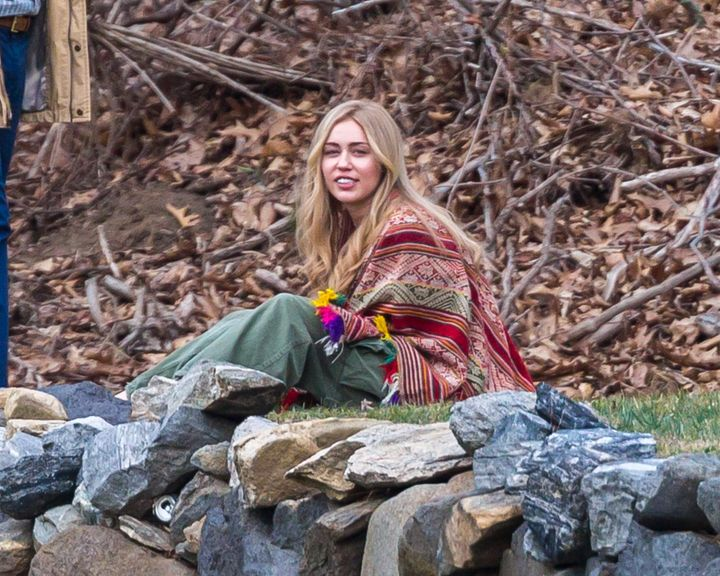 Miley Cyrus in long wig and hippie outfit seen filming Woody Allen's Amazon Project.