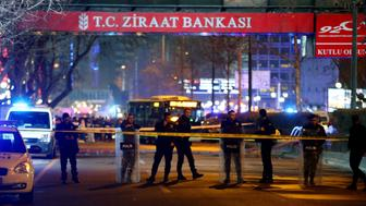 Policemen stand guard the streets after a blast in Ankara on March 13, 2016. An explosion ripped through a busy square in central Ankara on March 13, killing 25 people and wounding 75 more, with local media reports describing it as an attack. Ambulances rushed to the scene of the explosion on Kizilay square, a key shopping and transport hub close to the city's embassy area.  / AFP / ADEM ALTAN        (Photo credit should read ADEM ALTAN/AFP/Getty Images)