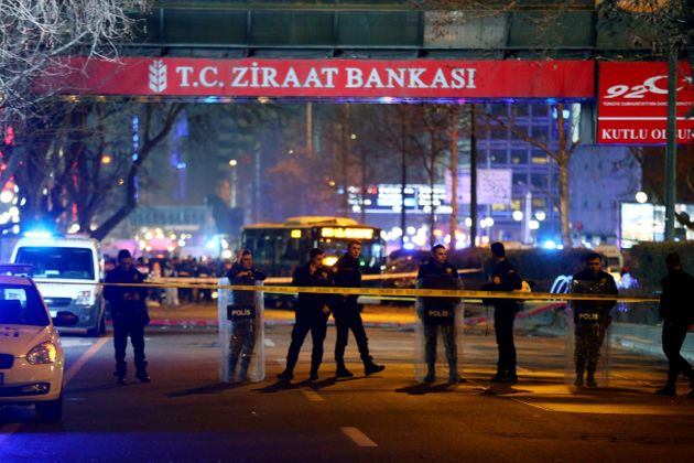 Policemen stand guard the streets after a blast in Ankara on March 13,