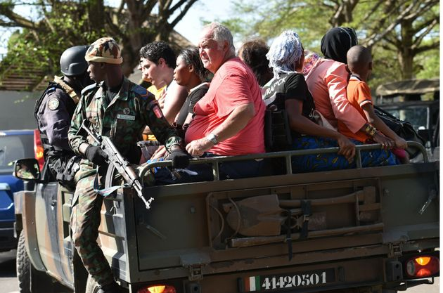 Ivorian security forces evacuate people after heavily armed gunmen opened fire on March 13,