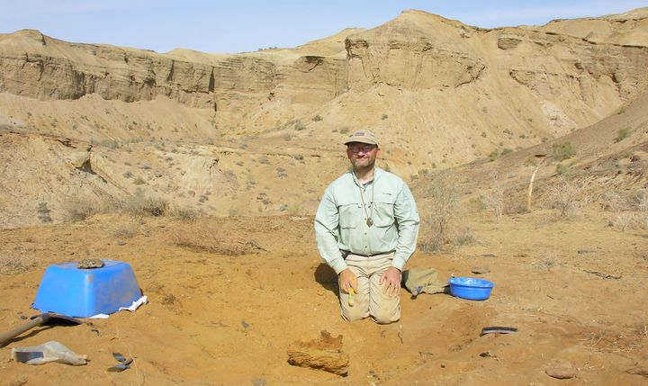 Suesexcavating a dinosaur fossil at Dzharakuduk in the Kyzylkum Desert of Uzbekistan, in September 2006.