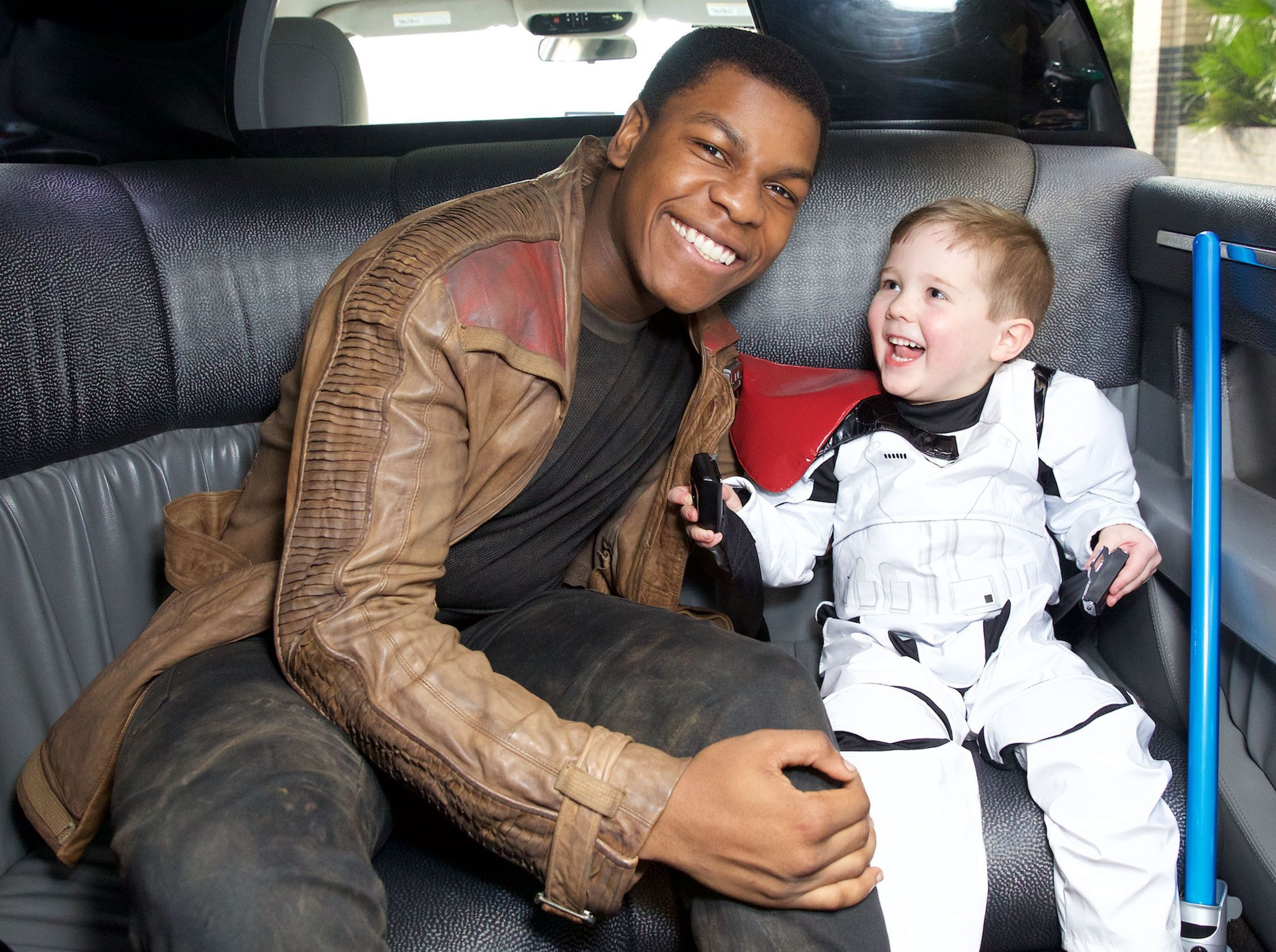"""Big-hearted Star Wars actor John Boyega meets sick children on a visit to a UK hospital.John, 23, who plays Finn in Star Wars: The Force Awakens, even got to show off his lightsaber at the Royal London Hospital. He visited with the Rays of Sunshine Children's Charity where he got to meet five-year-old Daniel Bell who is living with a brain tumour. He asked to deliver toys with 'Finn' to young patients being treated at the hospital.Rosalind, Daniel's mum, said: """"Daniel loves Star Wars and especially Finn - he thinks he is super cool and runs around the house pretending to be him every day.""""John Boyega said: """"When I heard about Daniel's wish to meet Finn, I jumped at the chance to make it come true. """"It was fantastic to be a part of his very special wish with Rays of Sunshine.""""It was also great to meet the children at The Royal London Hospital and be a part of something so positive.""""Tara Shea, Play Team Leader at The Royal London Hospital, added: """"We were so honoured to be asked to help make Daniel's wish come true, to meet Finn and give other children in hospital gifts.""""Rays of Sunshine Children's Charity brightens up the lives of seriously ill children in the UK aged three to 18 years old by granting wishes, granting hospital ward wishes and organising outings and large scale events for seriously ill children, including The Rays of Sunshine Concert.*MUST CREDIT Splash/Rays of Sunshine* <P>Pictured: John Boyega meets Daniel<B>Ref: SPL1244968  140316  </B><BR/>Picture by: Splash/Rays of Sunshine<BR/></P><P><B>Splash News and Pictures</B><BR/>Los Angeles:310-821-2666<BR/>New York:212-619-2666<BR/>London:870-934-2666<BR/>photodesk@splashnews.com<BR/></P>"""