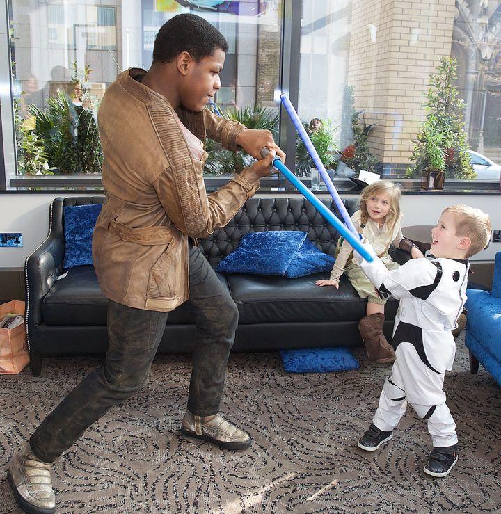 John Boyega and Daniel show off their lightsaber skills.