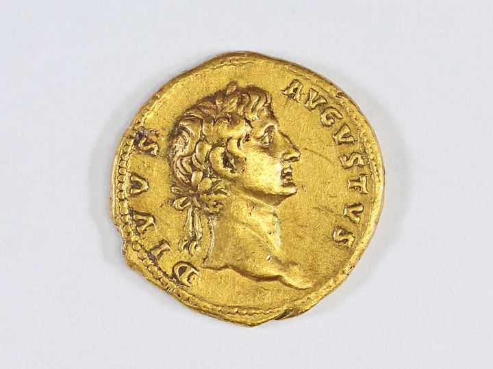 One side of the coin depicts Augustus, the founder of the Roman empire who ruled from 27 B.C. until his death in A.D. 14.
