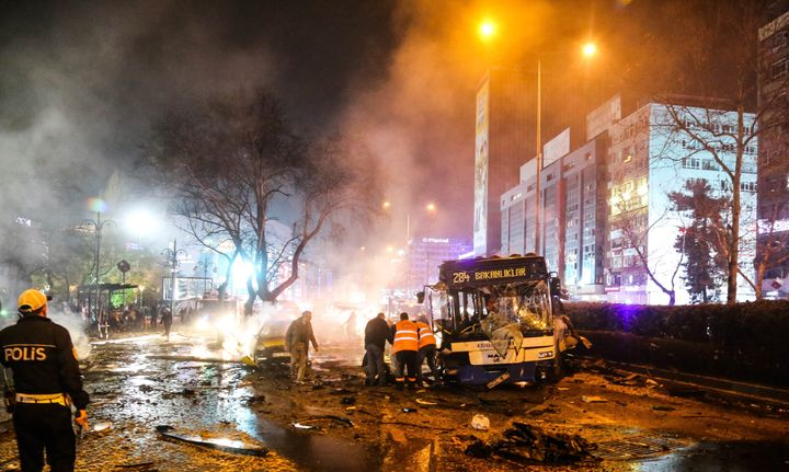 Emergency workers help victims after a car bomb attack in the Turkish capital of Ankara on March 13.