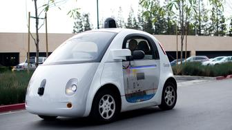 A self-driving car traverses a parking lot at Google's headquarters in Mountain View, California on January 8, 2015. AFP PHOTO/NOAH BERGER / AFP / Noah Berger        (Photo credit should read NOAH BERGER/AFP/Getty Images)