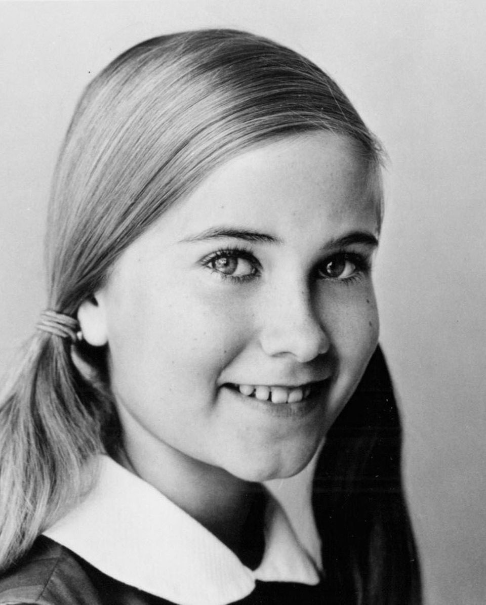Played by actress Maureen McCormick.