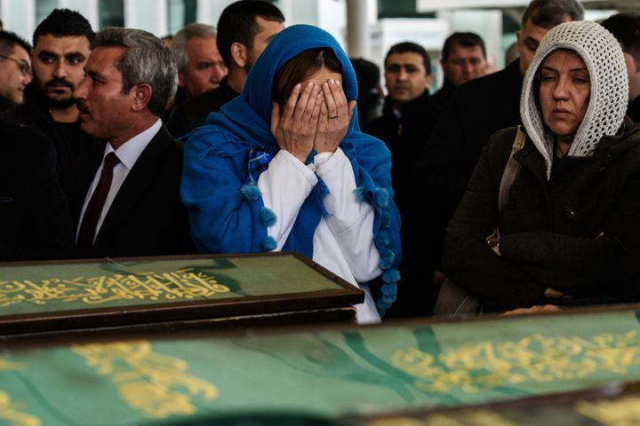 Women mourn near coffins during a funeral ceremony in an Ankara mosque on March 14 for the victims of a suicide car bomb that