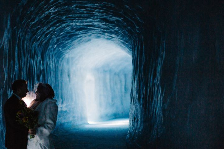 The bride and groom pose within the Langjökull Glacier in Iceland on March 3.