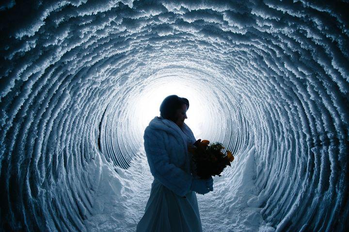 A magical bridal portrait within the glacier.