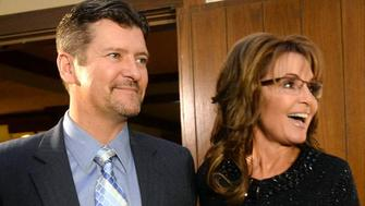 Sarah Palin, right, former Governor of Alaska, and her husband, Todd, arrive at the Grove Park Inn for a celebration of Billy Graham's 95th birthday in Asheville, N.C., on Thursday, Nov. 7, 2013. (Todd Sumlin/Charlotte Observer/MCT via Getty Images)