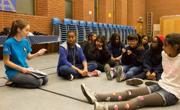 Girlguiding peer educators talking to younger