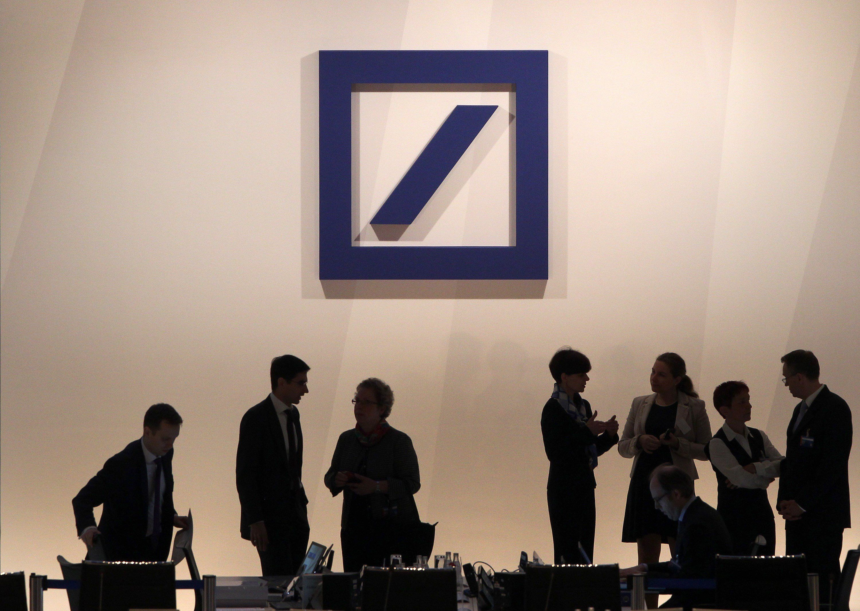 The logo of Deutsche Bank is pictured during the company's annual shareholder meeting in Frankfurt/Main, Germany, on May 21, 2015.  Deutsche Bank has launched an internal probe into its investments division in Russia, it said Wednesday, as the German media reported suspected money-laundering. AFP PHOTO / DANIEL ROLAND        (Photo credit should read DANIEL ROLAND/AFP/Getty Images)