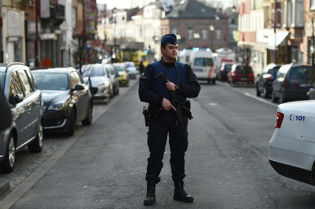 A police officer stands near the site of a shooting on Dries-Driesstraat at Forest-Vorst in Brussels...