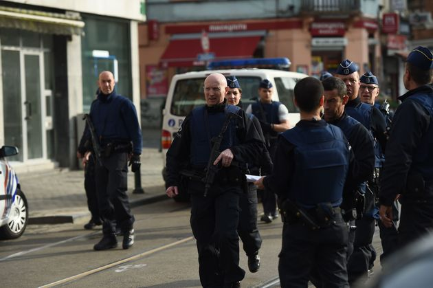Police officers walk in the street near the site of a shooting on Dries-Driesstraat at Forest-Vorst in...
