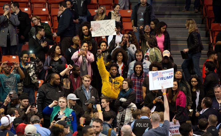 Protesters and Donald Trump supporters confront each other during a Trump rally at the UIC Pavilion in Chicago on March 11, 2