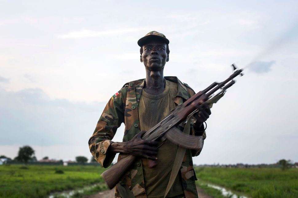 A member of the Lou Nuer tribe comes back home in the Yuai village in South Sudan on July 23, 2013 after fighting agains