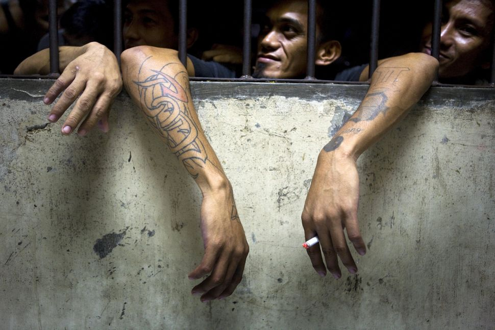 Male prisoners are crammed inside the detention cells of the Pasig City Police Headquarters on December 12, 2008 in Metro Man