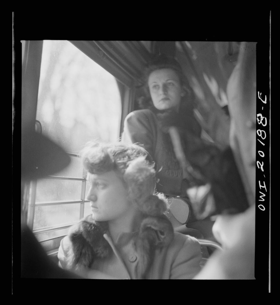Two women ride on a streetcar in Washington, D.C. in 1943.