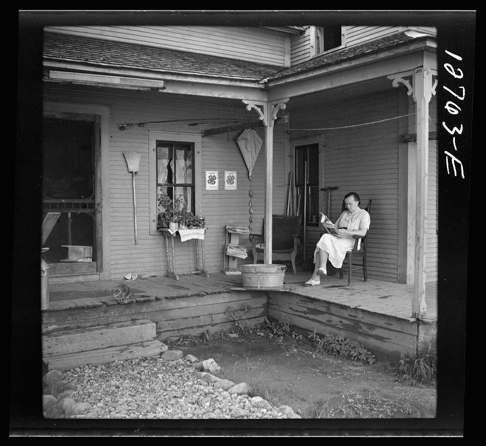 A woman sits on her front porch in Lincoln, Vermont in 1940.