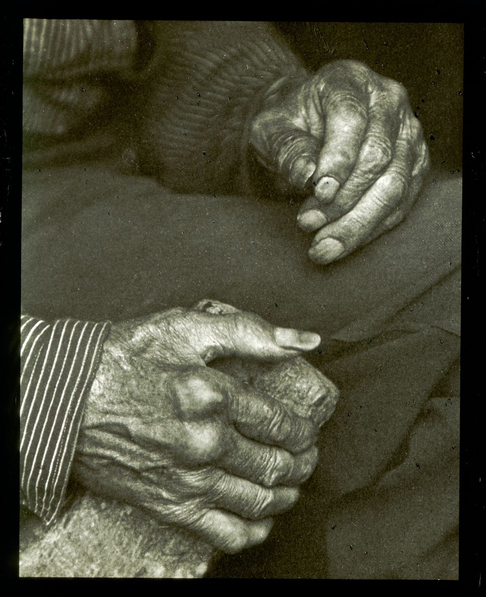 A photo of a laborer's hands, taken in 1925.