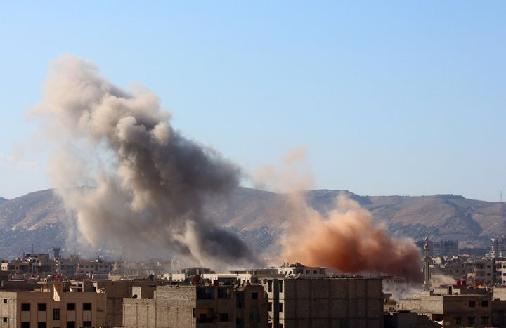 Smoke rises from residential areas after Russian airstrikes in Arbin, a town in the eastern Ghouta region. Russia conducted a