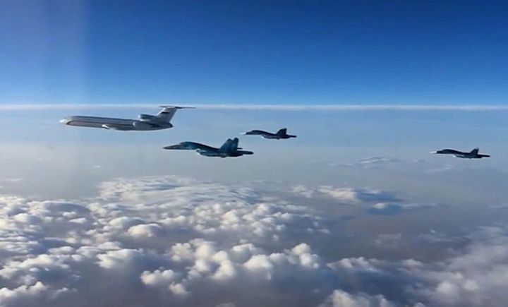 A Russian airliner and fighter bombers leave Hmeymim air base in Syria, flying toward Russia. The partial withdrawal of