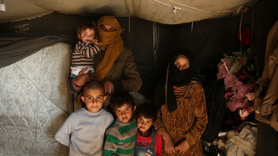 In this photo are Hassan and Razan, with their children Rami, Taraq, Firas and Yana, in the Lebanese refugee camp where they