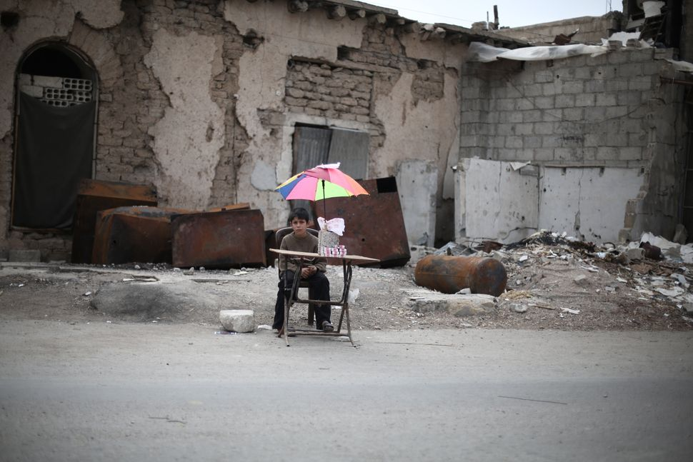 """""""Many children have been forced to leave school,"""" says Layth, who lives in a fenced area in Ghouta. Those who have lost their"""