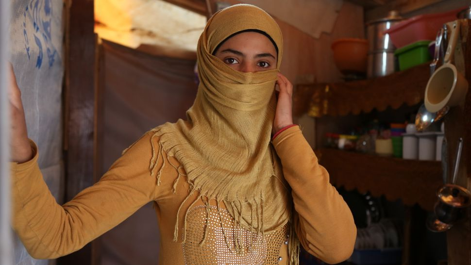 Mariam, 14, lives in a settlement in Lebanon with her brothers. Her family fled a rural area in Homs, Syria, after the siege