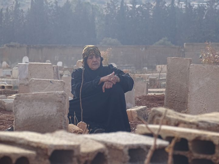 A woman visits a cemetery in Daraa, Syria, after her son was killed by regime forces. Some 470,000 people have died