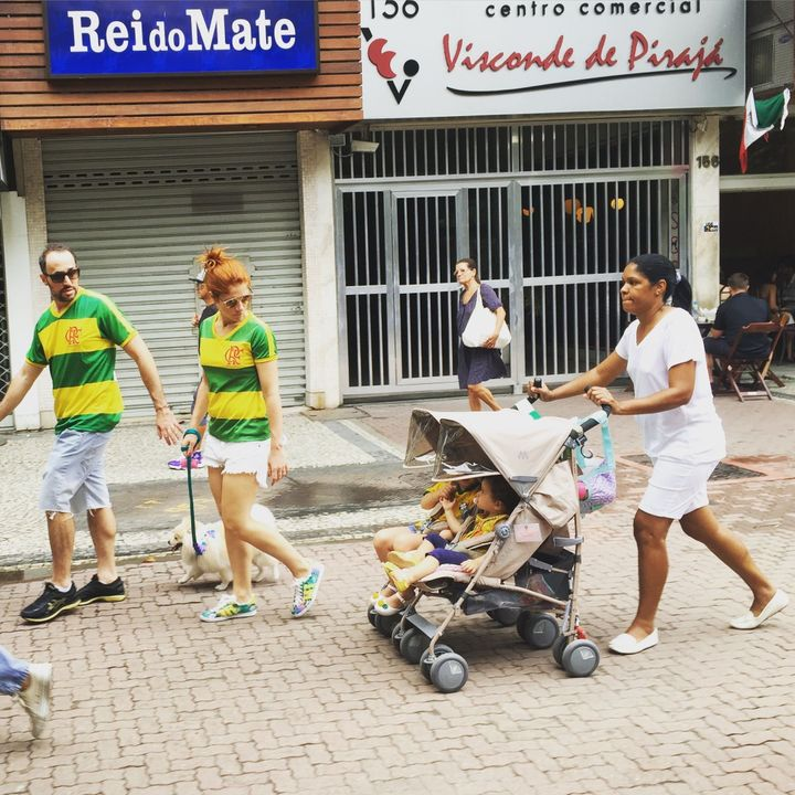This photo of Claudio and Carolina Maia Pracownik marching in Brazil's recent anti-government protests, while their nanny, Maria Angélica Lima, trails behind with their children, has gone viral on social media.