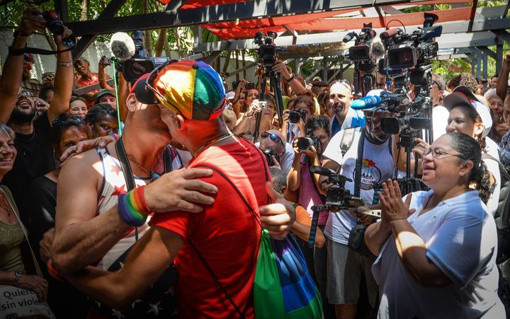 A couple performs a symbolic marriage during a gay parade in Cuba.
