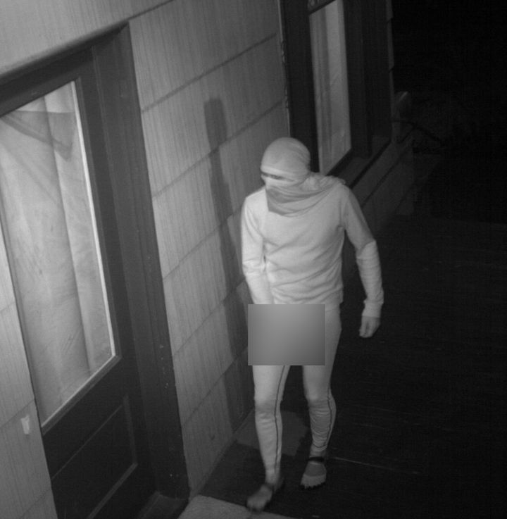 The masked masturbator has visited the home as many as four times, police say.