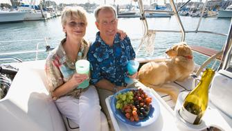 A0WYY8 Retired couple enjoy wine and snacks on their sailboat. Image shot 2007. retirement; recreation; baby-boomers; family; sail; sailing; recreation; boating; retirement; couples; vacation; ocean; outdoors; active; active; lifestyles; lifestyles; happy; sailboat; celebrate; celebration; weather; marriage; golden; years; wine; love; friends; age; old; fun; content; baby-boomers; couples; marriage; pets; dog; champaign; sail; sailing; recreation; boating; retirement; couples; vacation; ocean; outdoors; active; active; lifestyles; lifestyles; happy; sailboat; celebrate; celebration; weather; marriage; golden; years; wine; love; friends; age; old; fun; content