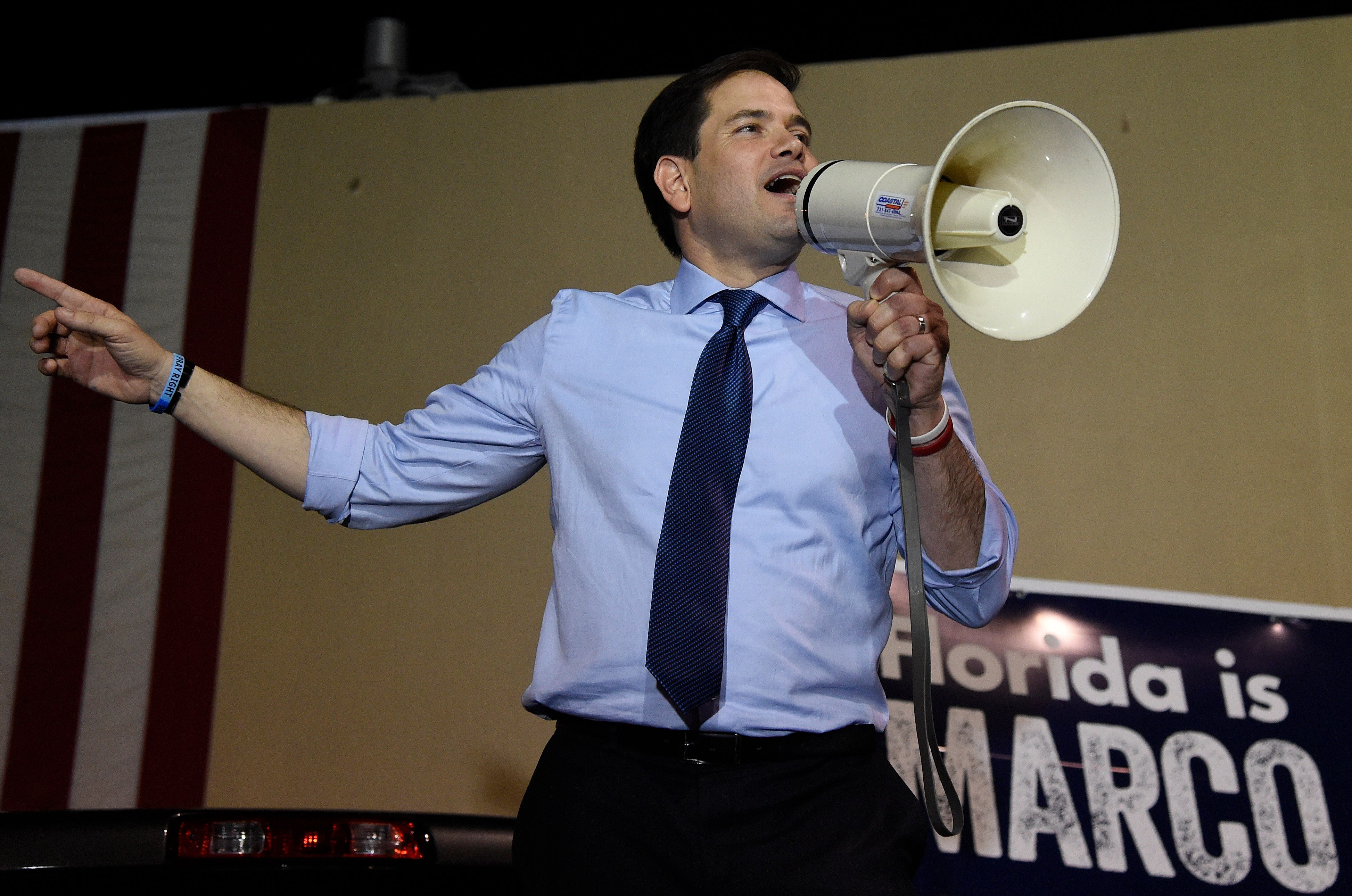 Florida Senator and Republican presidential candidate Marco Rubio addresses a rally on March 14, 2016 in Miami, Florida, on the eve of crucial primary voting. Rubio trails Republican contender Donald Trump in his home state by 20 points.  / AFP / RHONA WISE        (Photo credit should read RHONA WISE/AFP/Getty Images)