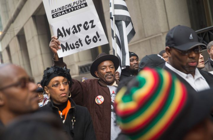 Demonstrators march around City Hall calling on Mayor Rahm Emanuel to resign on December 11, 2015 in Chicago, Illinois. A rec