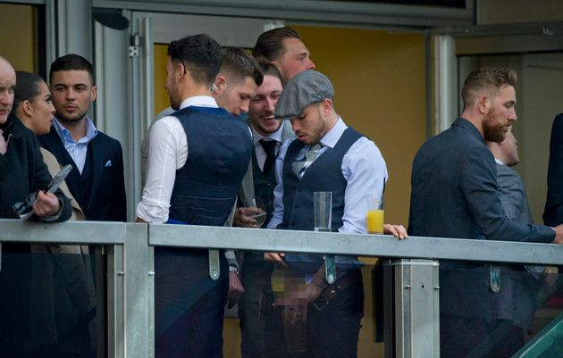 Samir Carruthers, wearing the grey flap cap, was shown appearing tourinate in a
