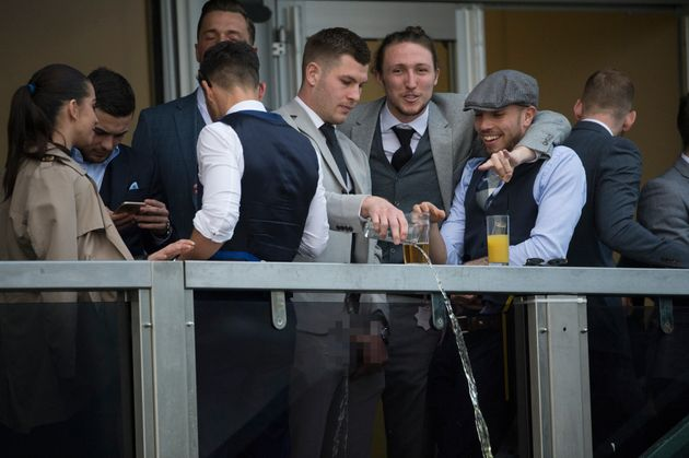 The liquid is thrown over the balcony as Carruthers looks on,