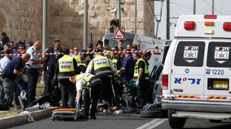 Israeli emergency personnel and security forces gather around the body of an attacker at the scene of a shooting attack outside Jerusalem's Old City's New Gate on March 9, 2016.  Two Palestinians opened fire at two different locations in Jerusalem, leaving one person seriously wounded, Israeli police said.   / AFP / AHMAD GHARABLI        (Photo credit should read AHMAD GHARABLI/AFP/Getty Images)