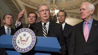 US Senate Majority Leader Senator Mitch McConnell (2nd L), Republican of Kentucky, speaks alongside Senator John Barrasso (L), Republican of Wyoming, Senator John Thune (2nd R), Republican of South Dakota, and Senator John Cornyn (R), Republican of Texas, during a press conference at the US Capitol in Washington, DC, March 8, 2016. / AFP / SAUL LOEB        (Photo credit should read SAUL LOEB/AFP/Getty Images)