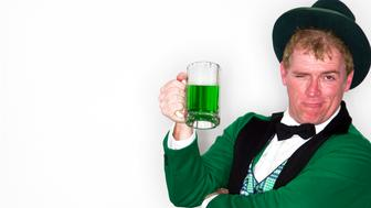 Man dressed as Leprechaun with mug of green beer