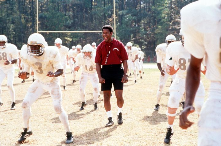 "Denzel Washington in a scene in ""Remember The Titans."""