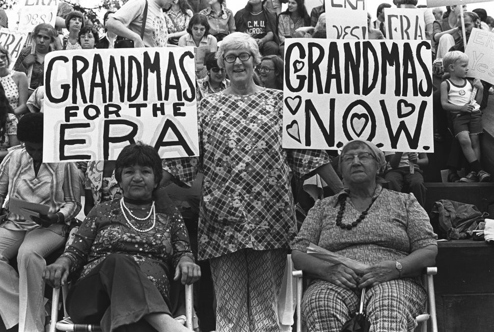 Women gather at a demonstration in support of passage of the Equal Rights Amendment in Pittsburgh, PA in 1976. Three foregrou