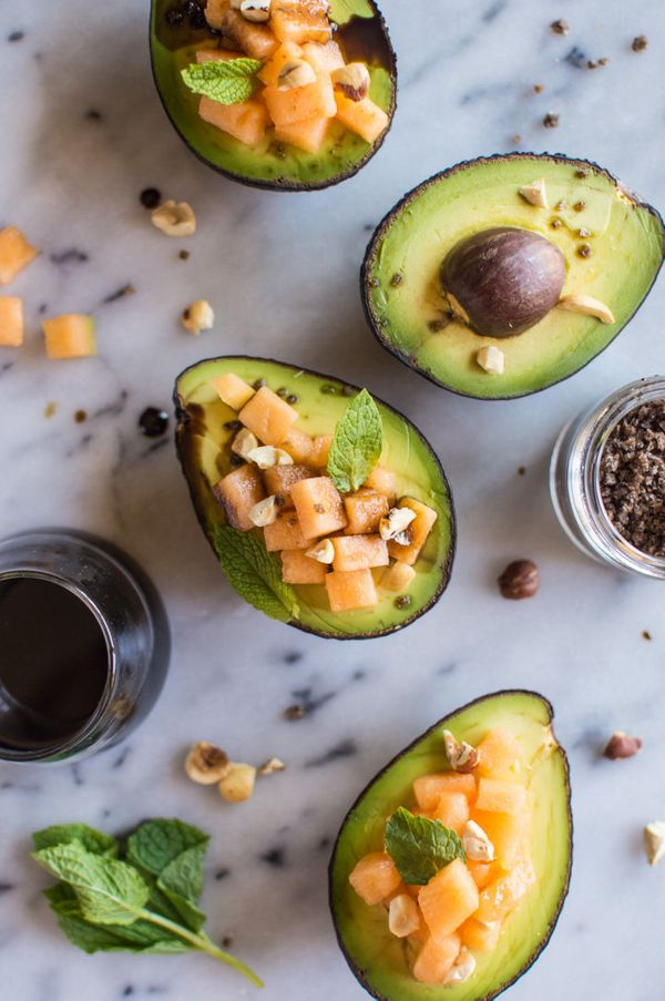 "Get the <a href=""http://healthynibblesandbits.com/avocado-cantaloupe-boats-with-pomegranate-reduction/"" target=""_blank"">Avoca"