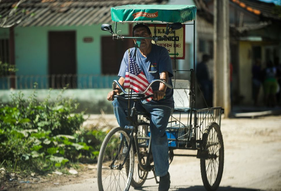A pedicab adorned with a U.S. flag is seen ona Havana.