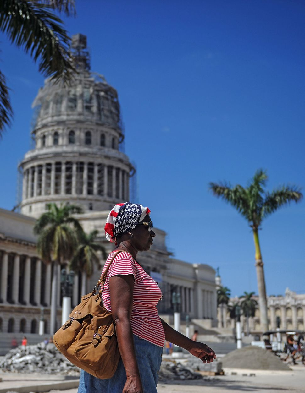 A woman wearing a headscarf in the colors of the U.S. flag walks near Havana's Capitol on March 15.